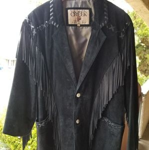 Men's black suede leather jacket worn by a ro